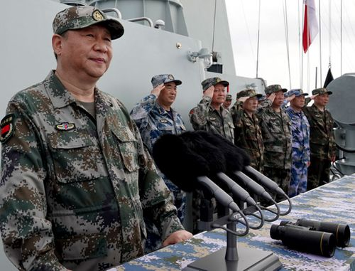 China President Xi Jinping, left, inspects a naval parade earlier this year.