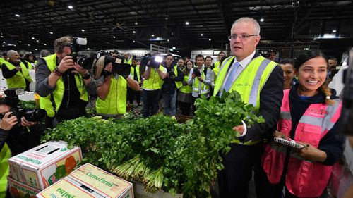 Scott Morrison and wife visit the Flemington markets in Sydney.