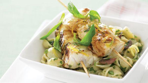 Fish skewers and warm pasta salad