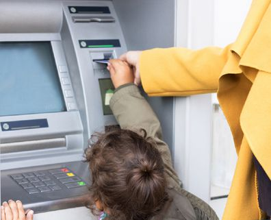 Mother and daughter at ATM