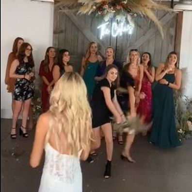 Wedding guest viciously rips the bouquet from another woman's hand