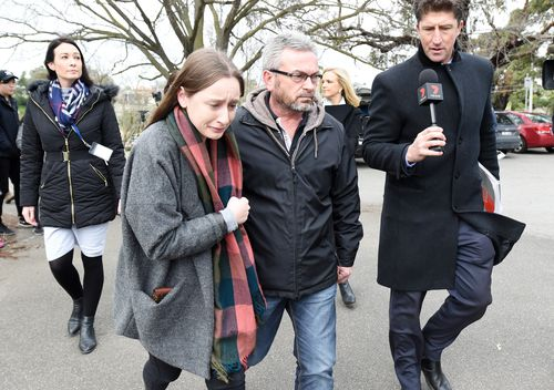 Borce Ristevski (centre right) the husband of missing Melbourne woman Karen Ristevski and their daughter leave a press conference after pleading for information as police search the Maribrynong River. Picture: AAP