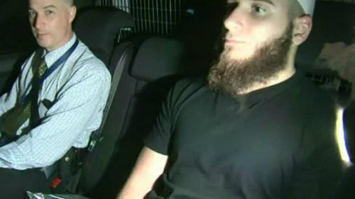 Agim Kruezi in police custody. Picture: 9NEWS
