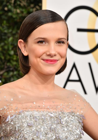 <p>Millie Bobby Brown is just 12 but she's well on her way to super stardom. We love this look on her - a perfectly appropriate dash of bold red lipstick and a touch of sheer makeup only. Why hide perfection.</p> <p>Image: Getty.</p>