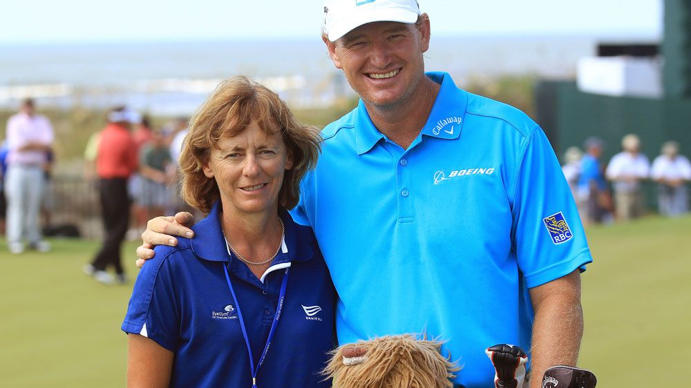 Dr Sherylle Calder with Ernie Els in 2012. (AFP)