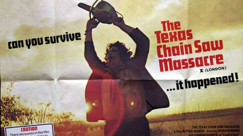 """The movie poster for the 1974 horror classic """"The Texas Chain Saw Massacre"""" shows Leatherface, the psychotic, chainsaw-wielding killer, played by Gunnar Hansen. (AAP)"""