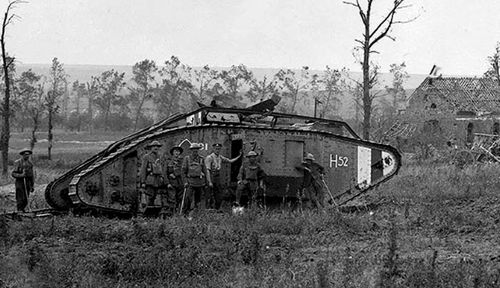 Australian soldiers with one of the British tanks that fought at Hamel. (Photo: AWM).