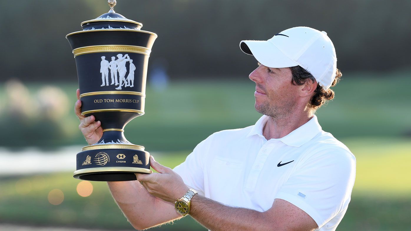 Rory McIlroy of Northern Ireland inspects the trophy after his victory in a playoff during Day Four of the WGC HSBC Champions at Sheshan International Golf Club
