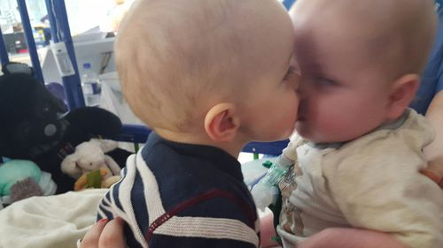 Baby twins reunited after 14 months apart as one underwent heart transplant