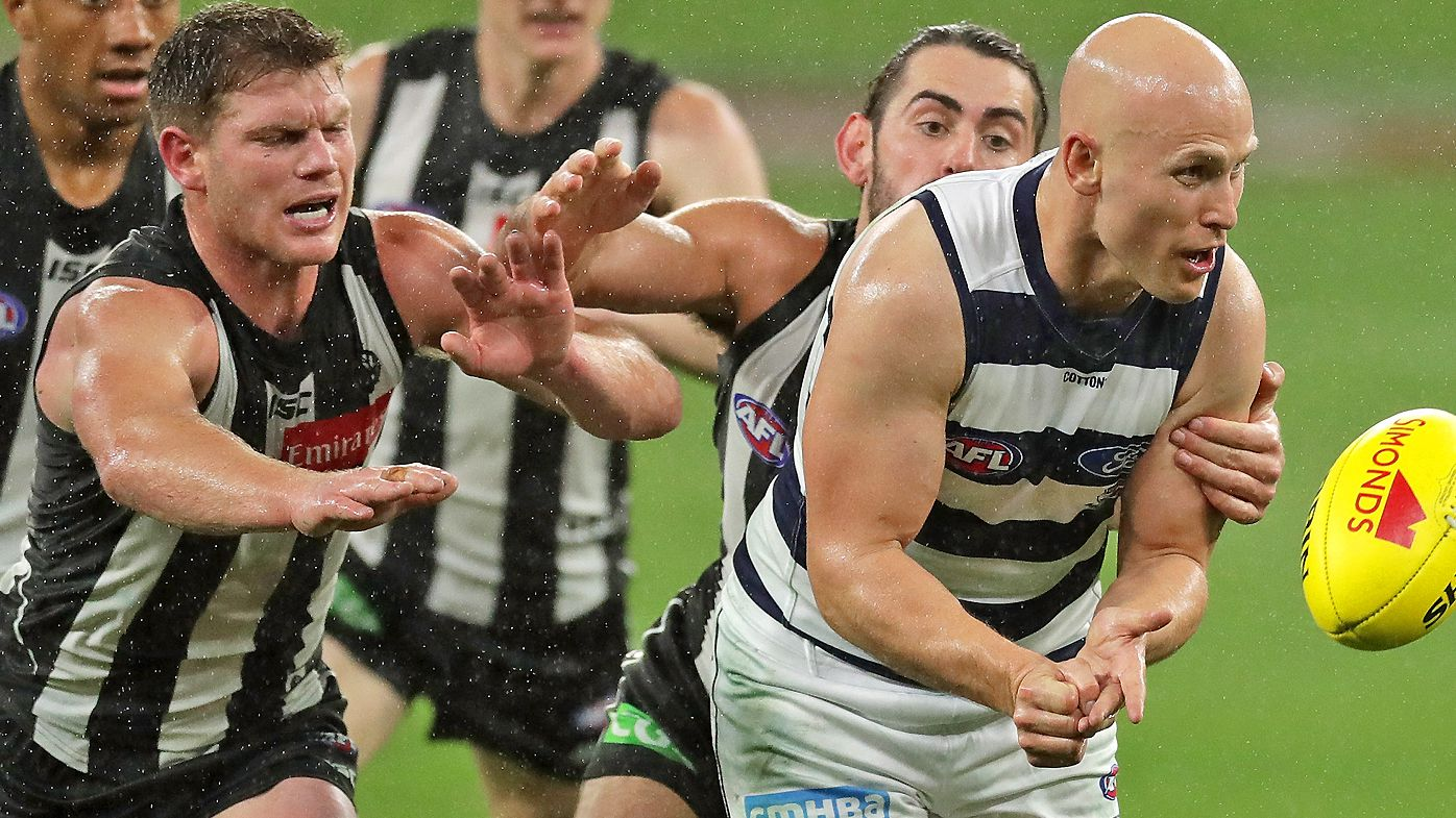 Gary Ablett of the Cats looks to pass the ball