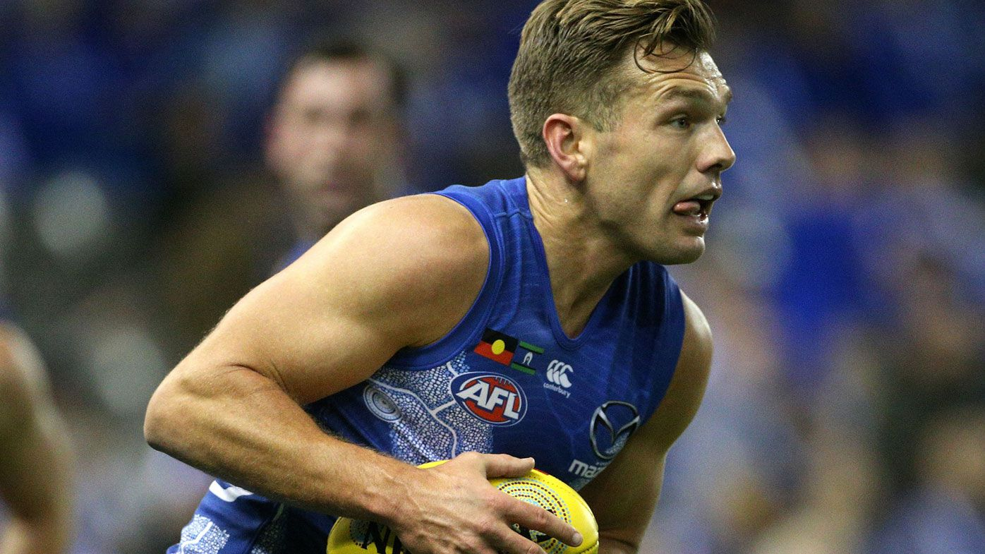 North Melbourne Kangaroos cruise past wounded Brisbane Lions in AFL