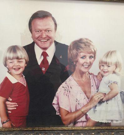 Bert Newton and Patti Newton pose with their two children.