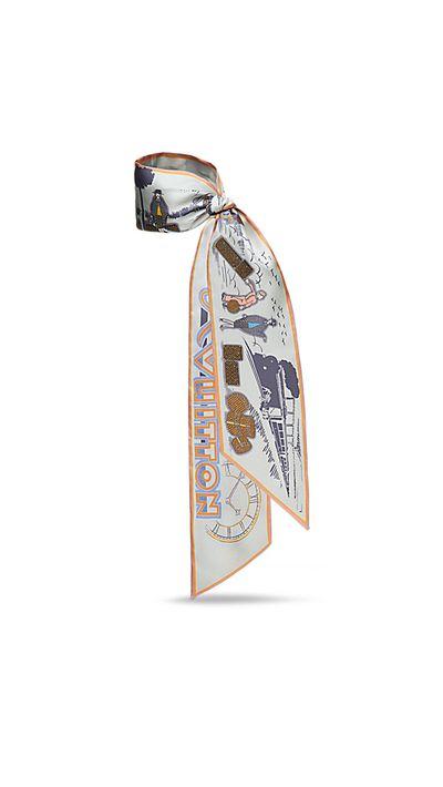 """<p><a href=""""http://au.louisvuitton.com/eng-au/products/lv-comics-bandeau-008412"""" target=""""_blank"""">LV Comics Bandeau, $275, Louis Vuitton</a></p>"""