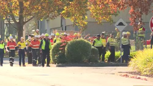 More than 100 workers were evacuated from the site. (9NEWS)