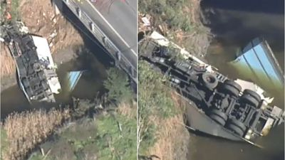 Driver critical after truck plunges into river