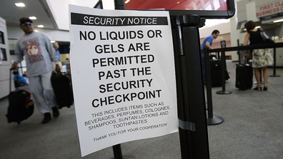 A man walks past a sign warning passengers not to bring liquids or gels past checkpoints at Raleigh-Durham International Airport August 10, 2006 in Wake County, North Carolina
