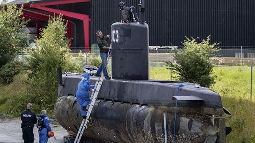 Police investigate Peter Madsen's submarine. Photo: AAP