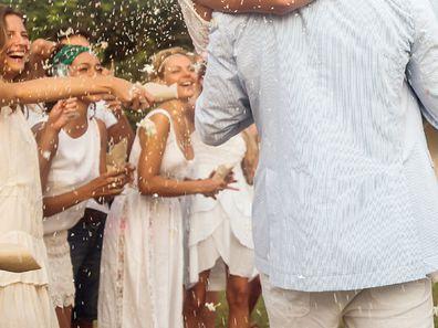 Wedding guests wearing white debate