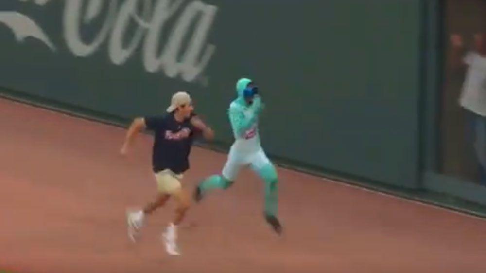 Fan eats dirt in race against superhero