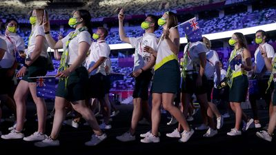 Australian athletes marque   their mode   into the stadium during the opening   ceremonial  of the Tokyo Olympics 2021.