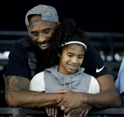 In this 2018 photo former Los Angeles Laker Kobe Bryant and his daughter Gianna are pictured at the US national championships swimming meet. The 18-time NBA All-Star who won five championships and became one of the greatest basketball players of his generation during a 20-year career with the Los Angeles Lakers, died in a helicopter crash on Sunday. Gianna also died in the crash. She was 13.