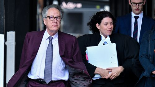 Australian actor Geoffrey Rush (left) arrives at the Federal Court in Sydney, Wednesday, October 24, 2018. Rush is suing Nationwide News for defamation.