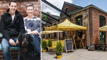 Jason Hoy and Melanie Hansche sit with their dog Hobart outside their cafe Tucker in the college town of Easton, Pennsylvania.