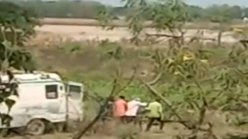 Footage on Indian news outlets appears to show ambulance staff throwing dead bodies into the Ganges River, as India buckles under a coronavirus second wave.
