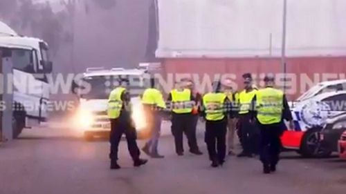 Uniformed police inspected 40 trucks in Minchinbury at dawn. Picture: 9NEWS