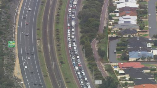 The Kwinana Freeway was closed for hours following the crash, causing traffic gridlock. Picture: 9NEWS