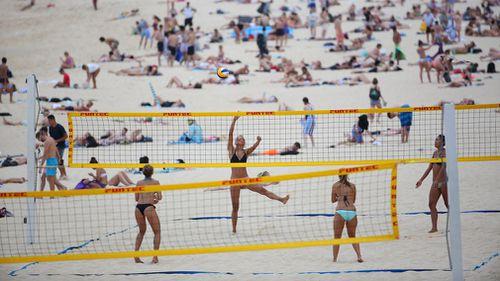 Volleyball players enjoy an Aussie beach. (AAP)