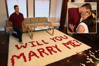 Kris surprised Kim with red rose petals spelling out 'Will You Marry Me?' in her bedroom. Kim said she was 'in shock' and 'never thought it would happen at home'. It was all captured for her reality show <i>Keeping Up With The Kardashians</i>... rumours circled that Kim 'planned' the proposal.<br/><br/>Image: E!
