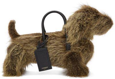 "Thom Browne Hector bag, $3150.20 at <a href=""https://www.ssense.com/en-us/women/product/thom-browne/brown-fur-hector-bag/1571723"" target=""_blank"">SSense</a>"