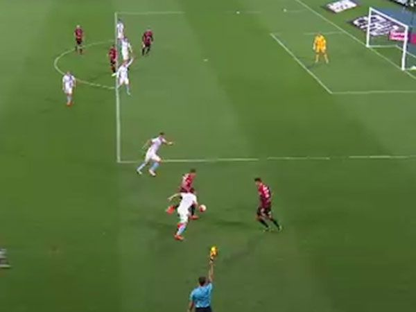 A linesman raises his flag for offside before the Wanderers' controversial goal. (Supplied)
