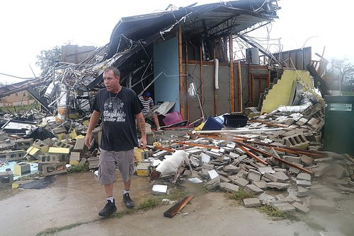 Brian Bon inspects the damage after Hurricane Michael smashed into homes in Panama City, Florida.
