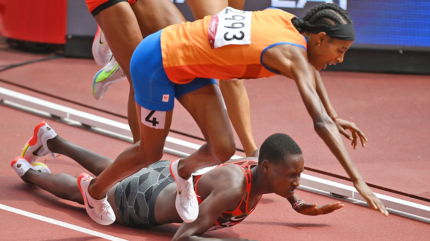 Sifan Hassan of Team Netherlands and Edinah Jebitok of Team Kenya trip and fall during round one of the Women's 1500m heats