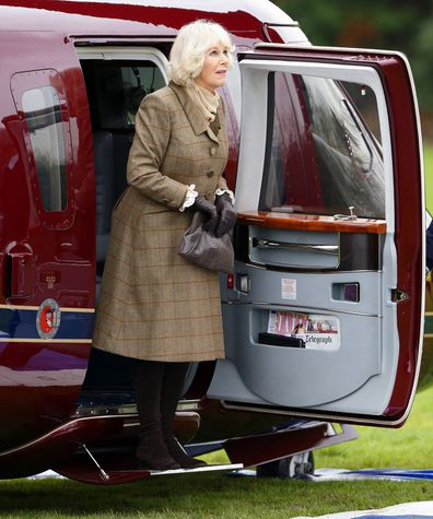 Camilla, Duchess of Cornwall, disembarking a Sikorsky Helicopter (The Queen's Helicopter Flight) in 2014.
