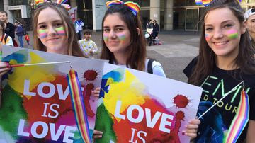 Same-Sex marriage activists Megan Robinson,16, Demi Foundas, 15, Emma Langan, 15, march during today's rally  in support of same-sex marriage in Sydney. (AAP)