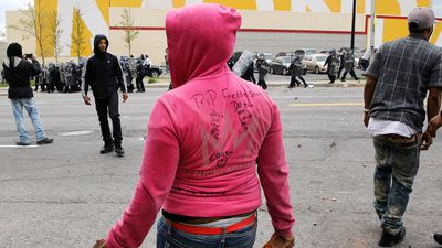 """RIP Freddie Gray"", a woman's jumper reads. (AAP)"