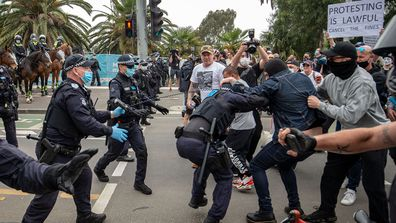 Protesters and members of Victoria Police clash on October 23, 2020 in Melbourne, Australia