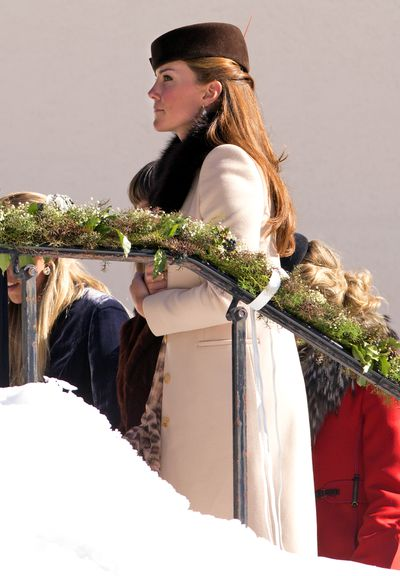 Pregnant with Prince George at the time, Kate looked Swiss chic in a chocolate James Lock & Co hat with a matching fur collar.