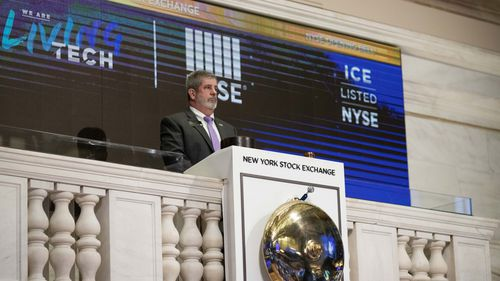 Tom Greene, the Vice President of Building Operations at the New York Stock Exchange, rings the opening bell, Friday, March 13, 2020.
