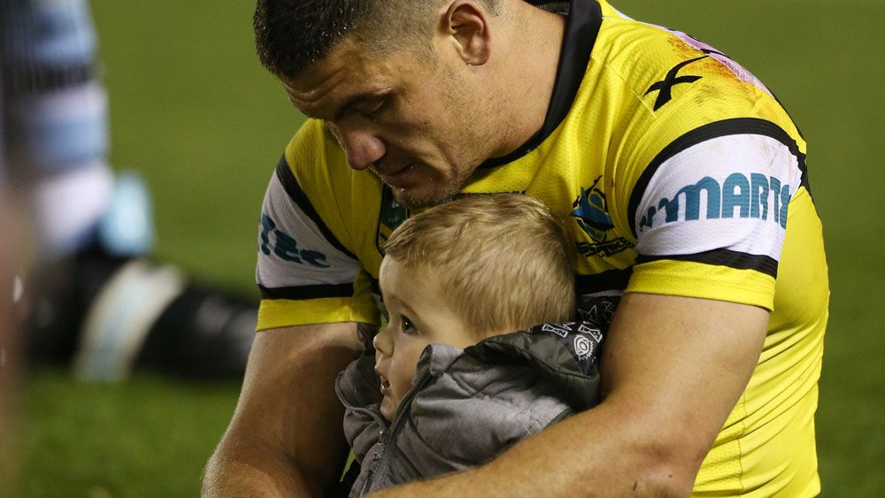 Sharks forward Chris Heighington and his son Rocco after a game in 2015. (AAP)