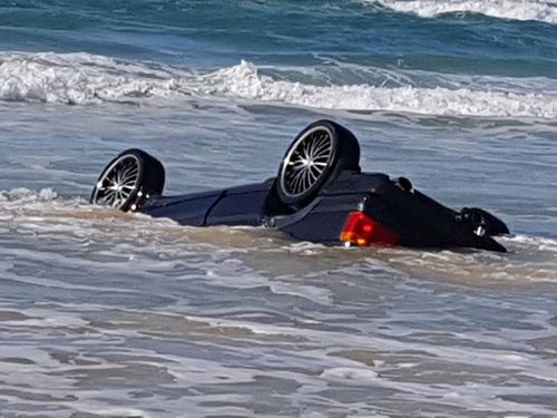 The movement of the waves and the wet sand slowly submerged the vehicle. (Queensland Ambulance Service)