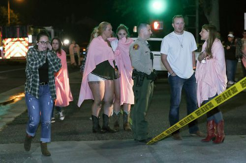 People who managed to escape the bar shooting were seen gathering outside the venue as police arrived.