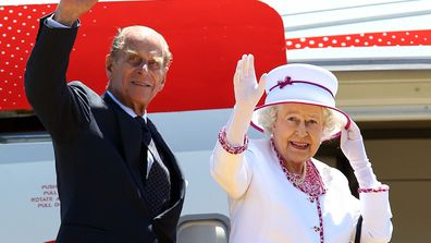 Queen Elizabeth II and Prince Philip, Duke of Edinburgh waving farewell to hundreds of people as they board their flight to London at the Perth International Airport on October 29, 2011. (AAP Image/Paul Kane)