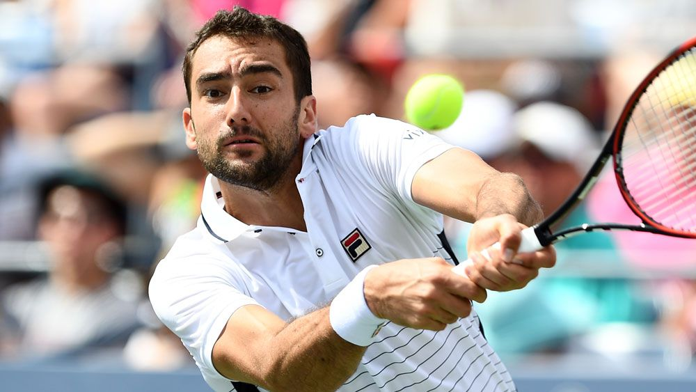 Former champion Marin Cilic has lost in straight sets to Jack Sock. (AFP)