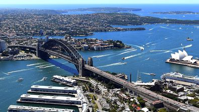 An aerial image shows North Sydney, Sydney Harbour Bridge and the Sydney Opera House.