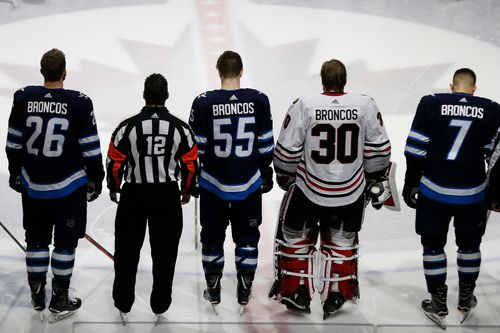 The Winnipeg Jets and the Chicago Blackhawks wore 'Broncos' on the back of their jerseys. (AP)