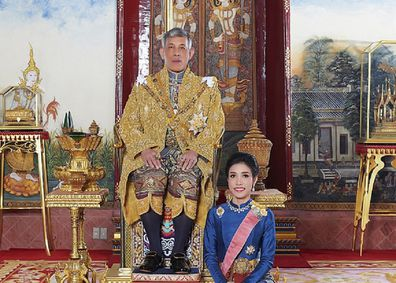 The King of Thailand with his former royal consort.